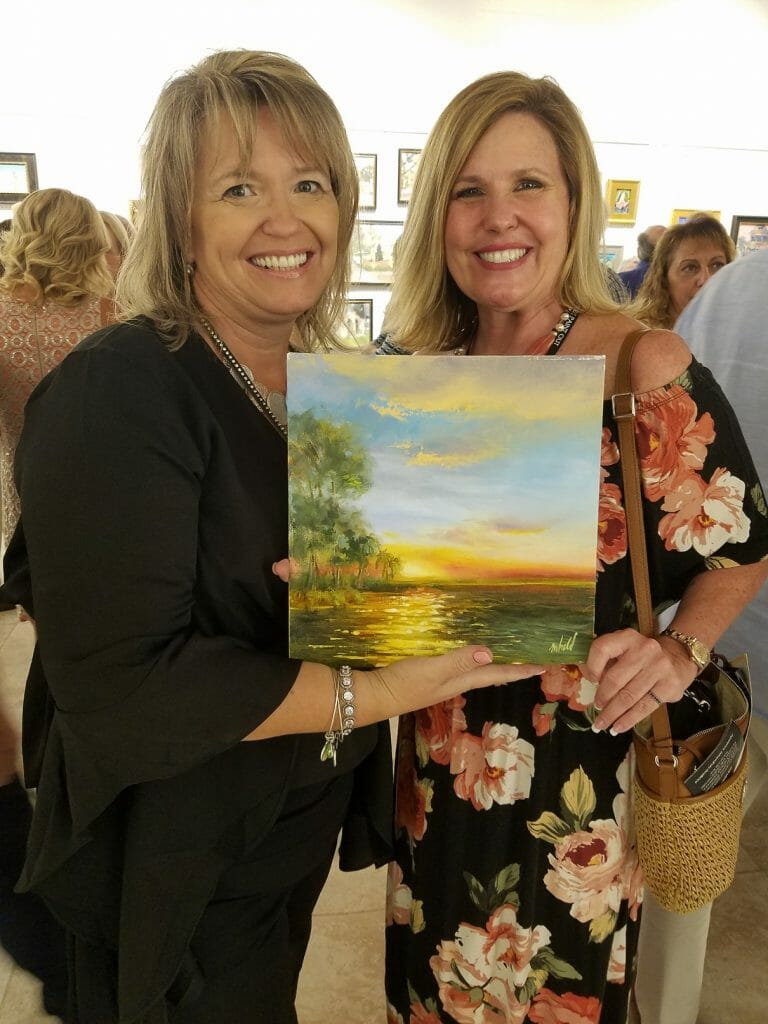 Winter Park Paint Out painter Michelle Held poses with Local Kelly McFall, who purchased her original plein air painting from the WPPO 'Paint In' event at the Winter Park Racquet Club.